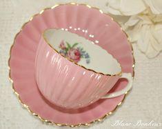 Coalport, England: Pink tea cup & saucer with flowers