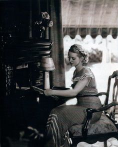 Bette Davis writing a letter at home.