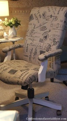 Recovered desk chair (that's Hobby lobby fabric) by Confessions of a Serial DIYer.