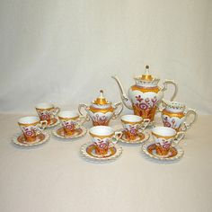 @Overstock.com - Intricate pink and gold floral designs embellish and set apart this unique coffee set. Included are six cups and saucers, a coffee pot, creamer container and a sugar container.http://www.overstock.com/Home-Garden/Three-Stars-15-piece-Pink-Gold-Floral-Coffee-Pot-Set/7258632/product.html?CID=214117 $99.99