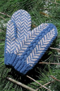 These classic herringbone mittens have a new twist added with cables on the back and sides. Colorwork and cables work together to create this unique design suitable for him or her.Full color pictures, charts and written instructions will guide you through each step. The techniques in the pattern include colorworked cables, cabled ribbing and stranded motifs. Different sizes can be achieved using different needle sizes, and differing weights of yarn which may increase or decrease your yardage…
