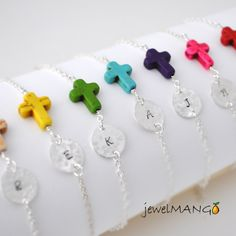 colorful cross initial bracelet. maybe can make this with shrinky dink and clear stretchy string and beads.