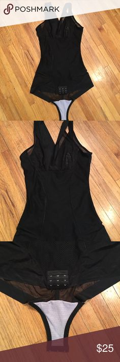 Black body shaper Slip on black body shaper. Never worn before runs small. For this to fit I would have probably had to go up two sizes. Purchased through Groupon just trying to make a little bit of my money back. Make a reasonable offer. Other