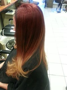 Red to blonde ombre. Hair by Trisha