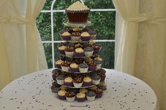 Purple, silver and white wedding cupcakes with vanilla giant