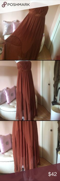 Brown zig zag cut strapless dress Zig zag cut on the bottom. Very interesting and beautiful dress. Pictures don't justify its beauty. In person it's more beautiful. Dresses Strapless