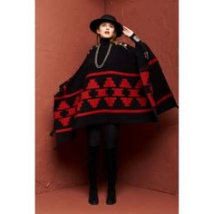 """Roja Collection designs are some of our favorites this season! This Pueblo Poncho is made of thick lambswool that is brought to life by bold red and black Native American inspired designs! This poncho will not only keep you warm this season but oh so stylish!! With a traditional over the head poncho cut this piece also features concho buttons on the shoulder to add to the Western aesthetic! These poncho's do not have a true bust but the width of the size 1 measures approx. 50""""."""