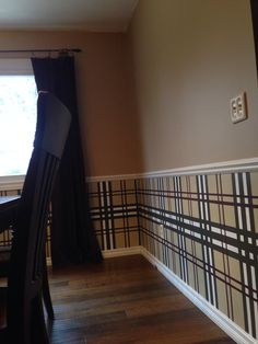 Hand-painted Burberry walls in dining room