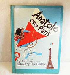 Anatole Over Paris by Eve Titus 1961 First Edition by CraveCute   Cute book about a giant kite that lifts Anatole the mouse and his family into the sky over Paris. Only Anatole's quick thinking can bring them safely home again.