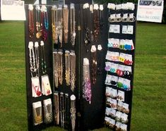 "Pegboard & Tin Display with company logo ... and from Rena, ""When a customer purchases an item from your booth at a show, but arranges to pick it up later, don't remove the piece from your display. Instead, put a ""SOLD"" tag on it to help stimulate interest in your work. People are more likely to buy when they see that other people are buying your work - and they feel a sense of urgency to buy now while you still have a selection for them to choose from!"""