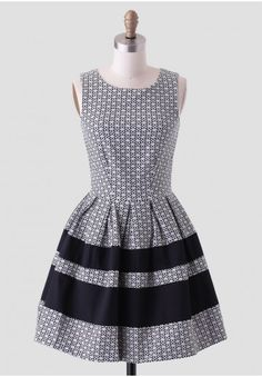 <p>Accented with black panels at the skirt, this white and black dress features a textured jacquard design with a floral motif. Perfected with box pleats for voluminous flare and an exposed zipper closure at the back, this adorable dress can be paired with colorful heels and delicate jewelry for a daytime soiree. Unlined, but opaque. By Closet.</p> <p>Self: 57% Cotton, 41% Polyester, 2% Elastane<br /> Contrast: 97% Cotton, 3% Elastane<br /> Designed and Made in London, England<br /> 29.5