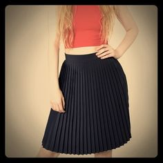NWT American Apparel black, pleated skirt ✔️ NWT American Apparel pleated, black skirt ✔️ Size: M, mensures 23 inches in length. New & never been worn.  American Apparel Skirts