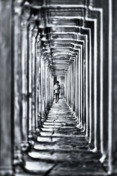 45)She followed it. The surroundings changed...from the rain to what seemed to be a corridor or cloister.