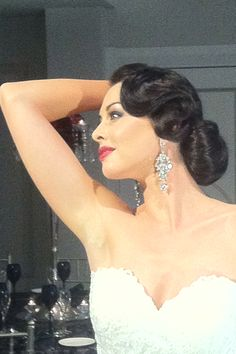 Hairstyle 6: The finger wave with a low bun is classic glam! It would be a hit on you!
