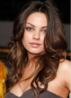 The long waves on actress Mila Kunis will elongate a long face. Waves are better on a round face than curls, which makes a round face seem even wider. If you have curly hair, ask your stylist to remove some of the volume and try to grow it out. The longer curly hair is, the more the curls are weighed down.