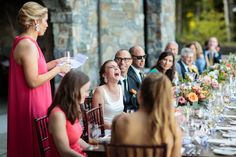 Lake Placid Lodge candid wedding photo of bride laughing a maid of honor's speech