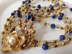Lapis and gold three strand vintage flower necklace by TheDragonsStash