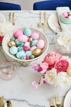 This Easter brunch embraces pastel colors with touches of gold. Florals and eggs decorate the tables in true Easter style.