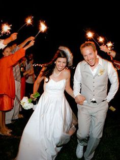 Light the Way    If you left the ceremony with your guests throwing rose petals, you simply have to give them something else to do at the end of the reception. Sparklers like these will look great in photos and your guests will have fun holding them for you while you two run under the arch.