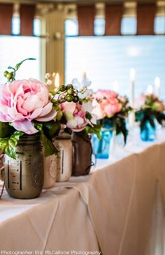 Paint mason jars and fill with silk peonies for your rustic wedding decor.  Find everything you need a t Afloral.com