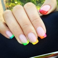 Rainbow gradient manicure is designed as a French with long nail plate. Base neutral body color brings color accents to the fore. Bright colors represent almost entire spectrum of the rainbow. This combination suits best summer season, when green trees and grass are all around, fruits and berries of different colors ripen, and the sun shines gold in a blue sky.