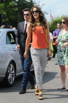 Kate Beckinsale seen wearing a neon statement necklace and neon Jimmy Choo sandals in Nottingham