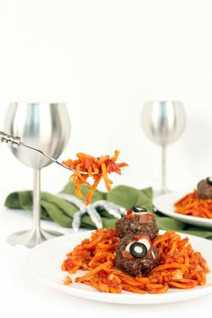 Oddly enough, spiralized sweet potatoes resemble worms when you top them off with meatballs for eyes. Whip this meal up for the perfect tasty (and spooky!) meal to impress dinner guests. Click through for the recipe and more Halloween party food ideas.