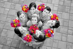 Bride and bridesmaids showing off their vibrant bouquets - Black and White photo with colorized flowers