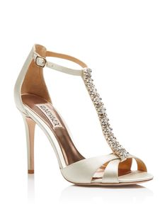 Channel Art Deco decadence with Badgley Mischka's spotlight-stealing satin evening sandals, finished with a row of dazzling crystal adornments. | Satin upper, leather lining, leather sole | Imported |