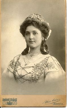 https://flic.kr/p/uD1qSQ | Beautiful young woman dressed up in Hungarian style | Cabinet card, around 1905-1908. Photographer:  Uher Ödön (Nagyszeben, 1859– Budapest, 1931)  Royal photographer - cs. és kir. udvari fényképész Budapest IV. Koronaherceg utca 2. No. 35 418 I think she interestingly combined the fashionable Gibson Girl hairstyle with traditional braids!