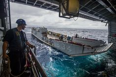 SOUTH CHINA SEA (Oct. 8, 2016) U.S. Navy Petty Officer 3rd Class David Coburn stands by as Landing Craft, Utility 1634, assigned to Naval Beach Unit (NBU) 7, embarks the well deck of the amphibious transport dock ship USS Green Bay (LPD 20) during Philippine Landing Exercise 33 (PHIBLEX). PHIBLEX 33 is an annual U.S.-Philippine bilateral exercise that combines amphibious landing and live-fire training with humanitarian civic assistance efforts to strengthen interoperability and working…