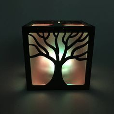 This adorable tree light box is a cute, whimsical decoration! The included LED light displays 16 different colors, each giving off a beautiful bright glow. The design is my own, and has been laser cut into 1/8 inch Baltic Birch which has been sanded, stained and finished by hand. The inside of the box is lined with frosted acrylic to diffuse the light and give a nice glow. Each box measures 4 x 4 x 4, and opens from the top. Included with purchase:  1 wood lantern 1 LED light (Batteries ...