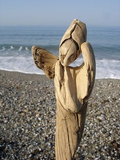 Wooden Angel by the ocean