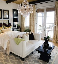 This Maria Theresa chandelier is the finishing touch on this light-filled bedroom.