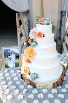 Rustic wooden tree stump cake plate and five tier wedding cake: http://www.stylemepretty.com/california-weddings/carmel-valley/2017/02/22/planning-a-fall-2017-wedding-this-holman-ranch-fete-is-a-must-see/ Photography: Julie Cahill - http://juliecahillphotography.com/
