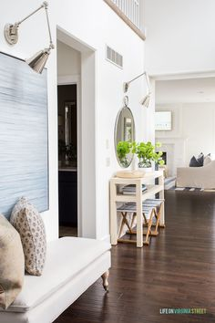 This 2020 spring home tour is filled with lots of blue and white decor along with greenery and floral stems. I love this blue front door, raffia console table, round mirror, striped benches and more! Decor, Painted Coffee Tables, Home, White Ceramic Lamps, Block Printed Pillows, Spring Decor, White Decor, Spring Home, House Tours