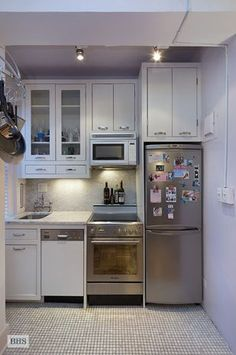 24 Fifth Avenue, small kitchen in an apartment in Greenwich Village, NYC, Manhattan, small kitchen, white cabinets, stainless steel appliances, tiny kitchen, apartment kitchen, compact kitchen #Appliances #WhiteHomeAppliances