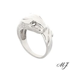 Sterling silver panther ring. The texture work was done by hand. #jewelry #panthers #animals #cat #ring #fashion