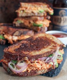 Barbecue Chicken Grilled Cheese. BBQ chicken breast, avocado, sautéed red onions, cilantro, and lots of mozzarella and cheddar cheese, sandwiched between whole wheat sourdough and grilled to perfection? HEAVEN. #ComfortFoodFeast #grilledcheese #BBQ