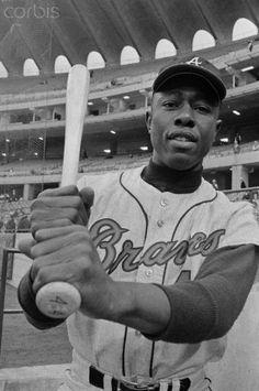 Hank Aaron Gripping Baseball Bat in Stadium