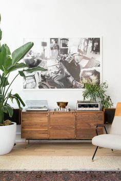 "Above the <a href=""http://organicmodernism.com/index.php?p=508"" target=""_blank"">console</a> from Organic Modernism, a black-and-white photo has... oh, insert see-no-evil monkey emoji."