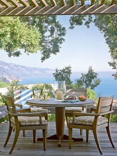 This Carmel, California cottage's wraparound porch showcases stunning views of both mountains and shores and features a trellis and easy access to the kitchen through French doors, perfect for al fresco meals. (Photo: David Tsay)