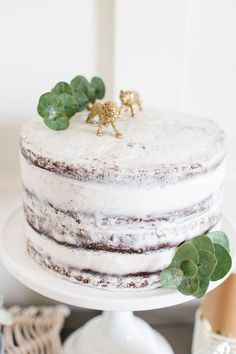 I adore this naked cake my friend Laurel from Sweet Laurel Blog made for our Boho Baby Shower! We added a few sprigs of eucalyptus and a couple of our extra DIY Metallic Animals to the top. It was the perfect finishing touch! See more on The TomKat Studio