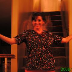"WHAT'S BEHIND HER? Lets just get right to it. This photo was taken of a family member in my old house on her first day at her new job. The ""thing"" behind her is what I am trying to solve, she believes it is a guardian angel, I don't know what to believe. It was taken on a sony digital camera, and there is no other photos on the staircase that could of led to a double image?"
