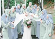 - A warm shot of the bride and her bridesmaids in a soft blue and mint attire. Love the choice of pastel color that brightens the mood. Double tap if you're a fan! Photo courtesy of . wedding checklist A warm shot of the bride and her b Bridal Hijab, Wedding Hijab, Wedding Poses, Wedding Bride, Bride Groom, Hijab Bride, Bridesmaid Poses, Bridesmaid Dress Colors, Bridesmaids