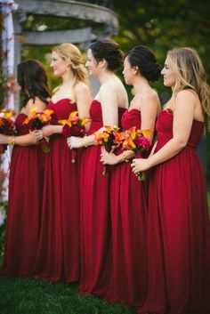 Red bridesmaid dresses a perfect color for a fall inspired wedding!