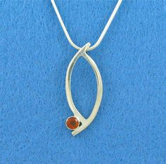 Sterling silver pendant with fire citrine. Handmade by Jeanne Boydston.