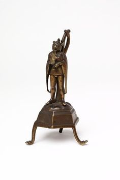 Germany, 14th century-15th century. Bronze. Statuette of a fool or jester playing on a bagpipe, mounted on an hexagonal pedestal which was originally the base of a candlestick. http://collections.vam.ac.uk/item/O89123/figure-unknown/