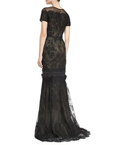 Carolina Herrera Short-Sleeve Tiered Lace Evening Gown. Fitted through hip; pleated trumpet sweep. High, round neckline; short sleeves. Back zip. Viscose/polyamide. Made in Italy. $5,990.00