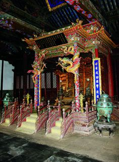 """The Shrine and the Imperial Throne in Chongzheng Hall. Elaborately decorated, the shrine stands on a wooden dais in front of the throne. Two golden dragons coil down from the top of the shrine. From """"Palace Architecture,"""" a volume of the Library of Ancient Chinese Architecture."""